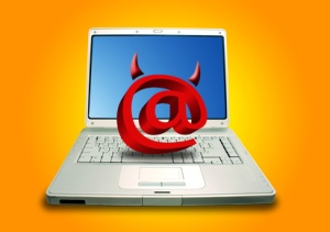 Laptop and Email symbol in devil shape